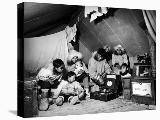 Eskimo Family Admiring their Modern Conveniences, a Victrola, a Sewing Machine and a Stove-Margaret Bourke-White-Stretched Canvas Print