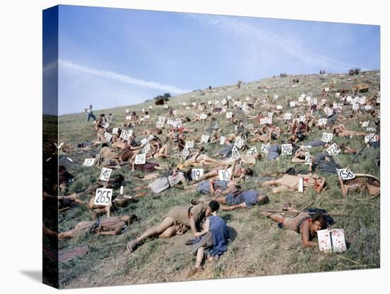 """Extras Playing Dead People Hold Numbered Cards Between Takes During Filming of """"Spartacus""""-J^ R^ Eyerman-Stretched Canvas Print"""