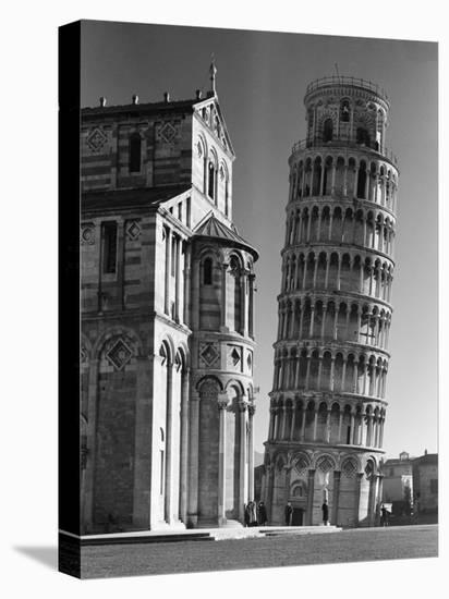 Famed Leaning Tower of Pisa Standing Next to the Baptistry of the Cathedral-Margaret Bourke-White-Stretched Canvas Print