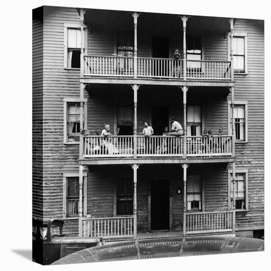Family on Balcony of Apartment Building-Gordon Parks-Stretched Canvas Print
