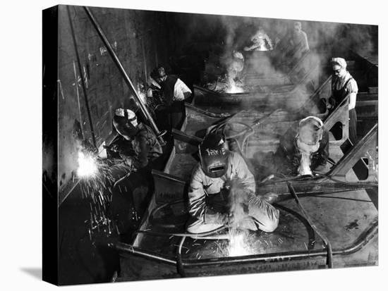 Female Welders Welding Seams on Deck Section of an Aircraft Carrier under Construction at Shipyard-Margaret Bourke-White-Stretched Canvas Print