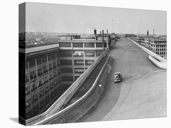 Fiat Car Driving Along the Desolate Street-Carl Mydans-Stretched Canvas Print