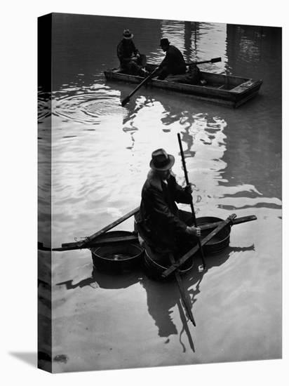 Flood Victim Paddling Boat Fashioned Out of Four Washtubs in the Flood Waters of Mississippi River-Margaret Bourke-White-Stretched Canvas Print