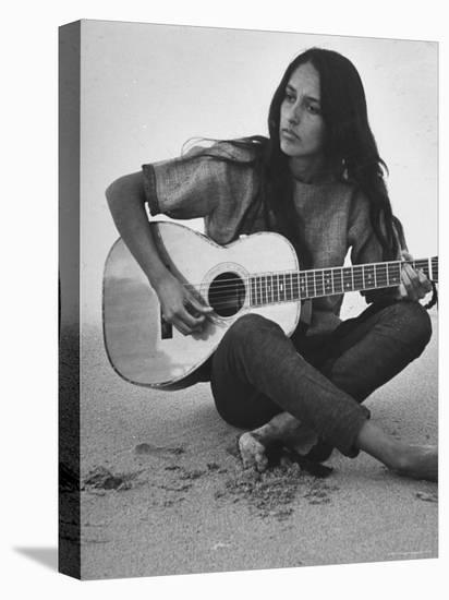 Folk Singer Joan Baez Strumming Her Guitar on the Beach Near Her Home-Ralph Crane-Stretched Canvas Print