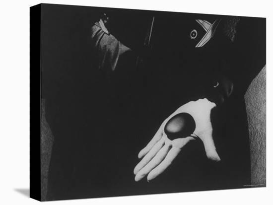 Georgia O'Keeffe Holding One of Her Favorite Stones in Her Palm-John Loengard-Stretched Canvas Print