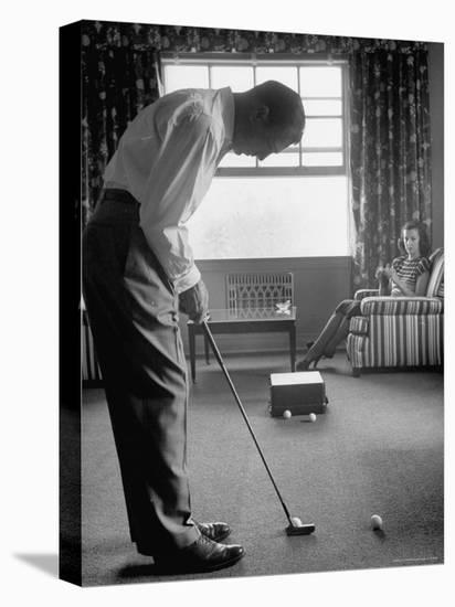 Golfer Ben Hogan Practicing Putting in His town house with Wife Valerie Watching from Armchair-Loomis Dean-Premier Image Canvas