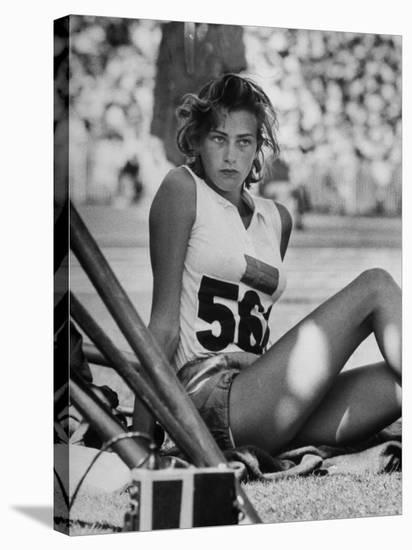 Gunhild Larking, Sweden's Entry for High Jump, Nervously Awaiting Turn to Compete at Olympic Games-George Silk-Stretched Canvas Print