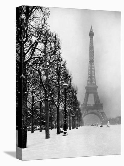 Heavy Snow Blankets the Ground Near the Eiffel Tower-Dmitri Kessel-Stretched Canvas Print