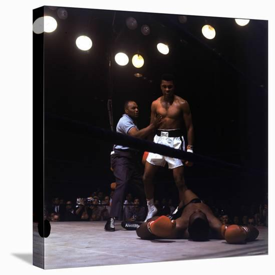 Heavyweight Boxer Cassius Clay, aka Muhammad Ali, Standing over Opponent Sonny Liston-George Silk-Premier Image Canvas