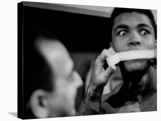 Heavyweight Contender Cassius Clay, Getting His Mouth Taped by Trainer Angelo Dundee-George Silk-Premier Image Canvas
