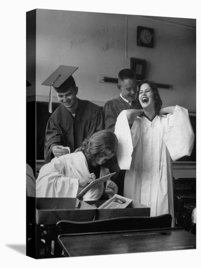 Hempstead High School Seniors Happily Helping Each Other with Graduation Gowns Before Commencement-Gordon Parks-Stretched Canvas Print