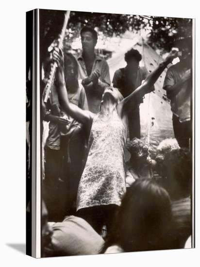 Hippie Girl Enthusiastically Playing Flute and Dancing at Woodstock Music Festival--Stretched Canvas Print