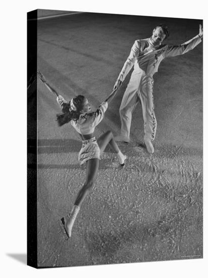 "Husband and Wife Skating Team Narena Greer and Richard Norris Skating with ""The Ice Follies""-Gjon Mili-Stretched Canvas Print"