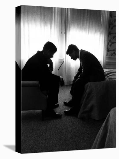 Jack Kennedy Conferring with His Brother and Campaign Organizer Bobby Kennedy in Hotel Suite-Hank Walker-Stretched Canvas Print