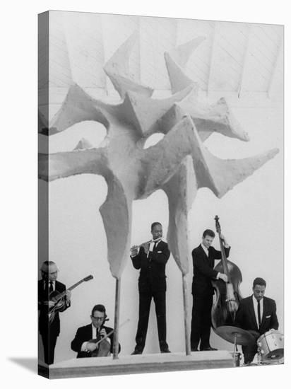 """Jazz Drummer Chico Hamilton Playing with Band Behind Sculpture Called """"Counterpoints""""-Gordon Parks-Stretched Canvas Print"""