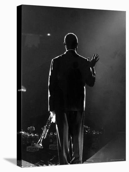 Jazz Trumpeter Louis Armstrong Waving to a Crowd of Adoring Fans as Their Applause Rolls over Him-John Loengard-Stretched Canvas Print