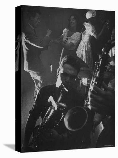 Jitterbugging at La Rose Rouge, with Saxophones Being Played in Foreground-Gjon Mili-Stretched Canvas Print