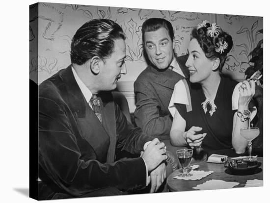 Joan Crawford Chatting with Artist Salvador Dali at Del Monte Resort-Peter Stackpole-Stretched Canvas Print