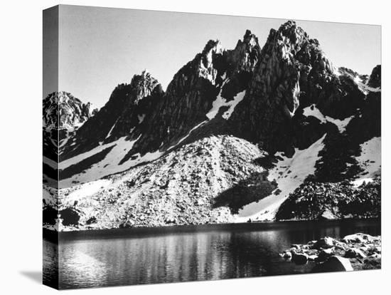 """""""Kearsarge Pinnacles,"""" Partially Snow-Covered Rocky Formations Along the Edge of the River-Ansel Adams-Stretched Canvas Print"""