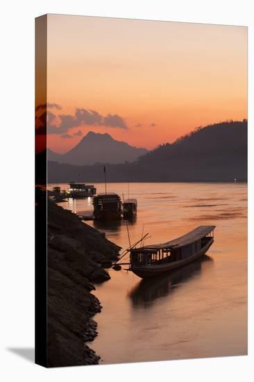 Laos, Luang Prabang, boats on Mekong River at sunset.-Merrill Images-Stretched Canvas Print