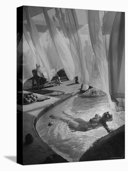 Lee Anderson Swimming Into Living Room of Raymond Loewy's House-Peter Stackpole-Stretched Canvas Print