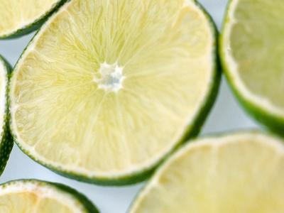 Limes in slices--Stretched Canvas Print