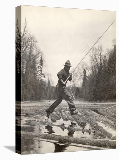 Log Driver Leaping Across Floating Logs to Keep Them Moving by Breaking Loose Any That Get Jammed-Margaret Bourke-White-Stretched Canvas Print