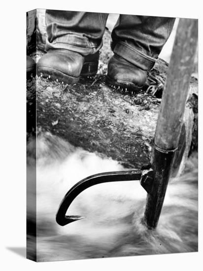 Log Driver's Feet Using a Peavey, to Control Lumber Floating Down River Headed for Paper Mill-Margaret Bourke-White-Stretched Canvas Print