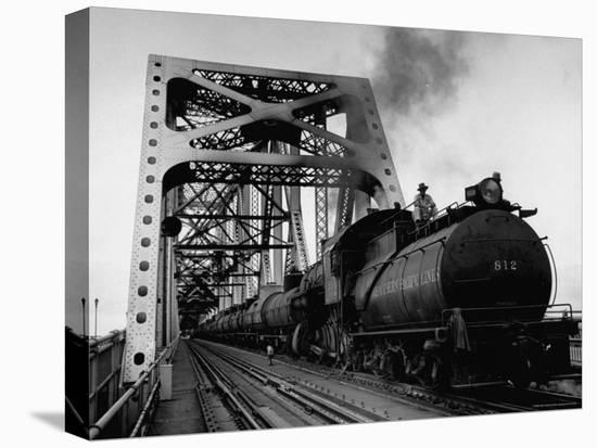 Long String of Tank Cars Rumbling Across the 4 1/2 Mile Huey Long Bridge at New Orleans-Peter Stackpole-Stretched Canvas Print