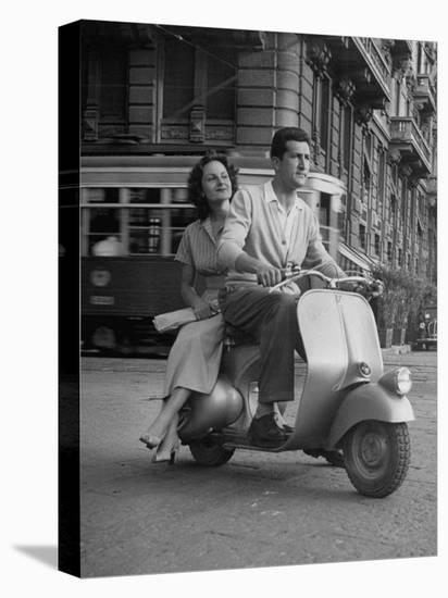 Man and Woman Riding a Vespa Scooter-Dmitri Kessel-Stretched Canvas Print