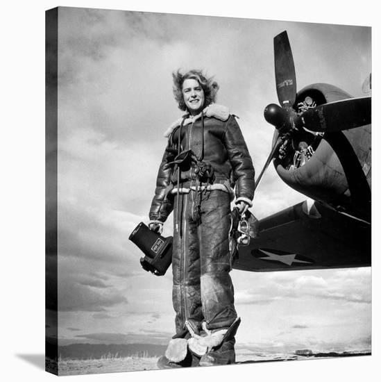 Margaret Bourke-White in Flight Suit, Holding Aerial Camera in Front of Flying Fortress Bomber-Margaret Bourke-White-Stretched Canvas Print