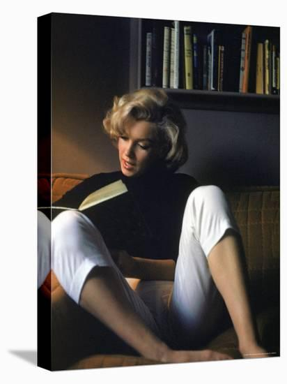 Marilyn Monroe Reading at Home-Alfred Eisenstaedt-Stretched Canvas Print