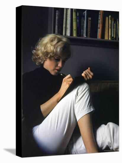 Marilyn Monroe Writing at Home-Alfred Eisenstaedt-Stretched Canvas Print