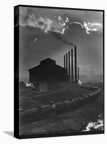 Massive Otis Steel Mill Surrounded by Tanker Cars on Railroad Track on a Cloudy Day-Margaret Bourke-White-Stretched Canvas Print
