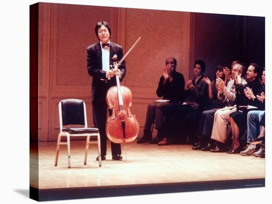 "Master Cellist Yo-Yo Ma with Stradivarius Cello Receiving Applause after performing ""Cello Suites""-Ted Thai-Stretched Canvas Print"