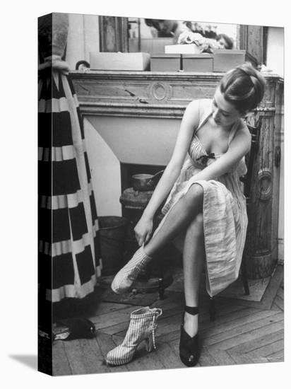 Model Changing Her Shoes For Pierre Balmain's Fashion Show-Nina Leen-Stretched Canvas Print