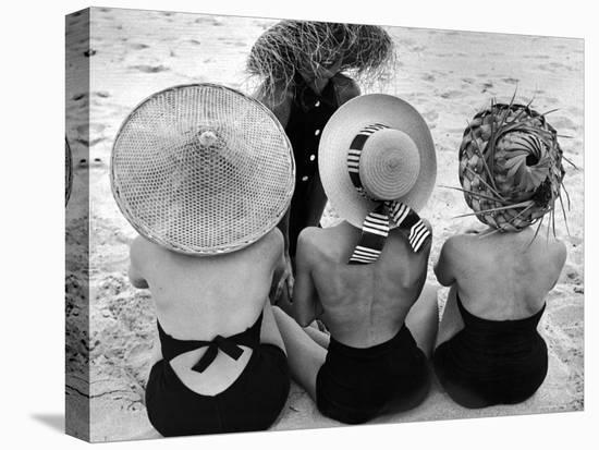 Models on Beach Wearing Different Designs of Straw Hats-Nina Leen-Stretched Canvas Print