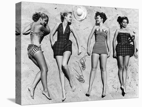Models Sunbathing, Wearing Latest Beach Fashions-Nina Leen-Stretched Canvas Print