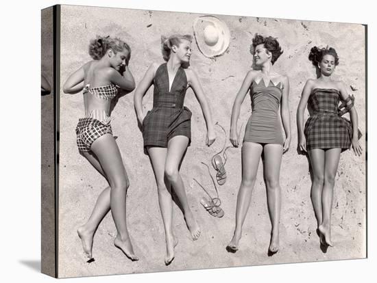 Models Sunbathing, Wearing Latest Beach Fashions-Nina Leen-Stretched Canvas Print