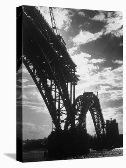 Multiple Arc Bridge under Construction Across the Dnieper River Below the World's Largest Dam-Margaret Bourke-White-Stretched Canvas Print