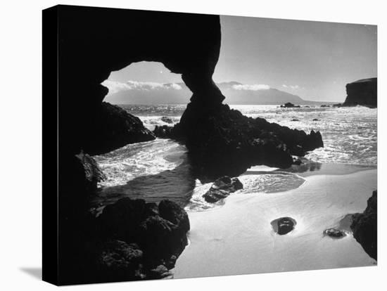 Natural Gateways Formed by the Sea in the Rocks on the Coastline-Eliot Elisofon-Stretched Canvas Print