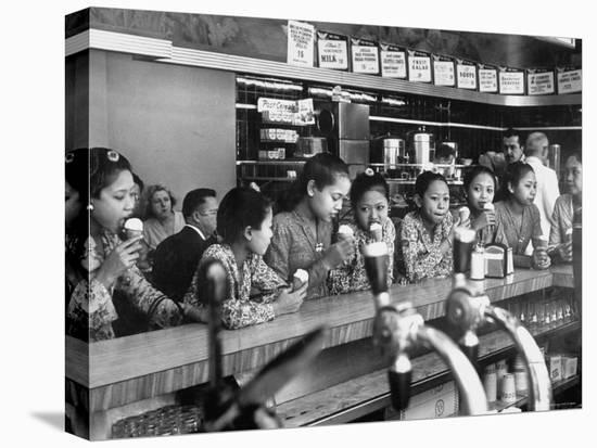New Delight For the Balinese Dancing Girls in America is Ice Cream-Gordon Parks-Stretched Canvas Print