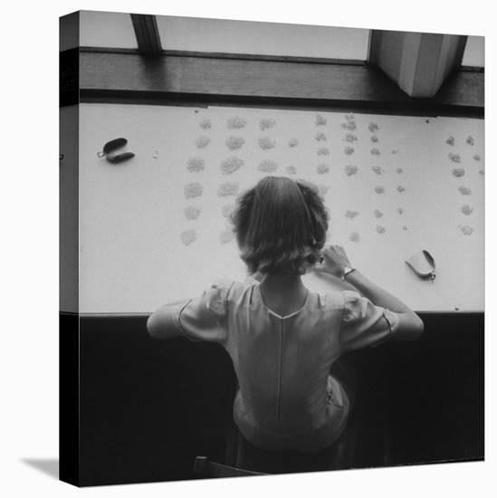 Newly Trained Girl Sorting Thousands of Dollars Worth of Diamonds-Bob Landry-Stretched Canvas Print