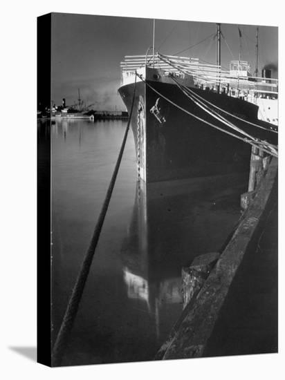Oil Tanker Tied Up at Dock While it Is Being Loaded with Barrels of Oil-Margaret Bourke-White-Stretched Canvas Print