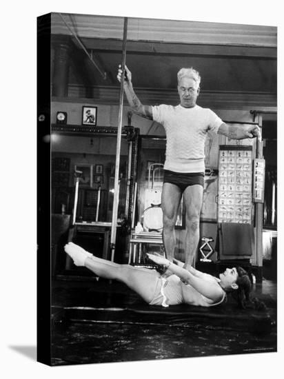 Opera Singer Roberta Peters Balancing Her Trainer, Joseph Pilates, on Her Operatic Breadbasket-Michael Rougier-Stretched Canvas Print