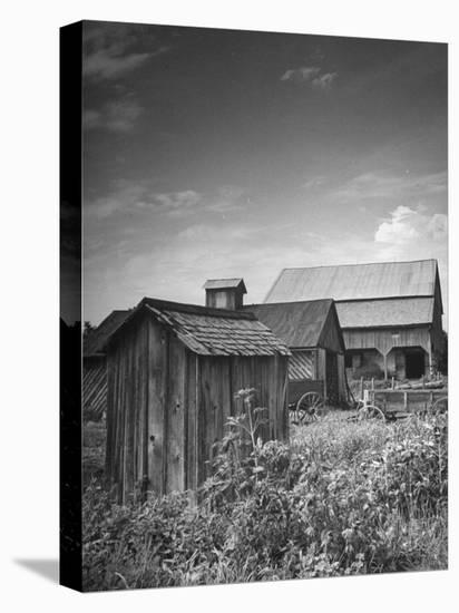 Outhouse Sitting Behind the Barn on a Farm-Bob Landry-Stretched Canvas Print