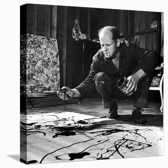 Painter Jackson Pollock Working in His Studio, Cigarette in Mouth, Dropping Paint Onto Canvas-Martha Holmes-Stretched Canvas Print