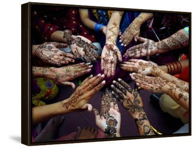 Pakistani Girls Show Their Hands Painted with Henna Ahead of the Muslim Festival of Eid-Al-Fitr-Khalid Tanveer-Framed Canvas Print