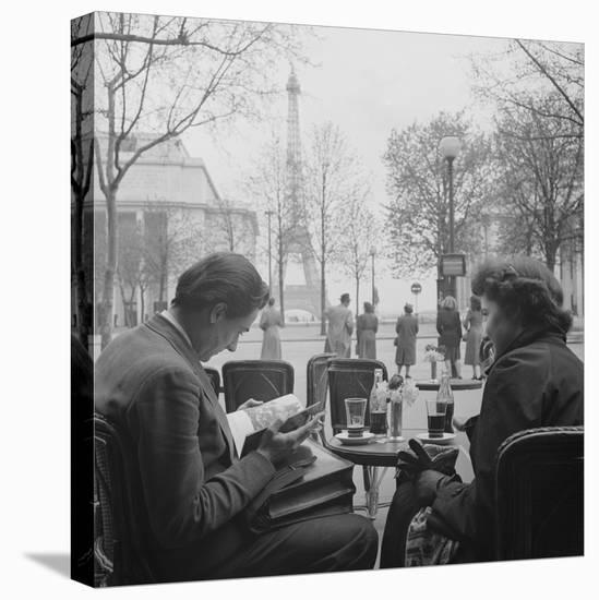 Parisian Couple Drinking Coca Cola at a Sidewalk Cafe While Reading, Paris, France, 1950-Mark Kauffman-Stretched Canvas Print
