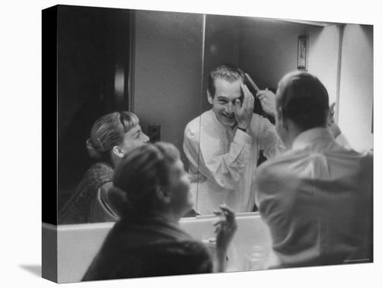 Paul Newman Talking to His Wife Joanne Woodward While Getting Dressed-Gordon Parks-Stretched Canvas Print